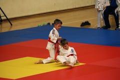 Jiu Jitsu fighters at Romanian Championship, Juniors, May 2018. Jiu Jitsu junior fighters in Kimono on tatami. Jiu-Jitsu Romanian Championship took place in Stock Images