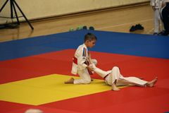 Jiu Jitsu fighters at Romanian Championship, Juniors, May 2018. Jiu Jitsu junior fighters in Kimono on tatami. Jiu-Jitsu Romanian Championship took place in Royalty Free Stock Photos