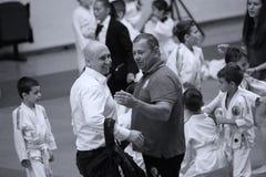 Jiu Jitsu Hanshi and Referee at Romanian Championship, Juniors, May 2018. Jiu Jitsu students in Kimono with Hanshi on tatami. Jiu-Jitsu Romanian Championship Royalty Free Stock Photography