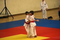 Jiu Jitsu fighters at Romanian Championship, Juniors, May 2018. Jiu Jitsu junior fighters in Kimono on tatami. Jiu-Jitsu Romanian Championship took place in Stock Photos