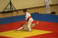 Jiu Jitsu fighters at Romanian Championship, Juniors, May 2018. Jiu Jitsu junior fighters in Kimono on tatami. Jiu-Jitsu Romanian Championship took place in Royalty Free Stock Image