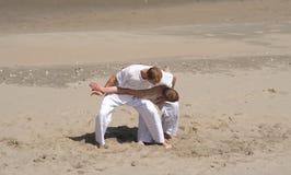 Jiu Jitsu Practice. Practicing tae kwon do on the beach Stock Photos