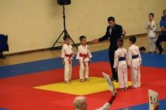 Jiu Jitsu fighters with Referee at Romanian Championship, Juniors, May 2018. Jiu Jitsu students in Kimono with Referee on tatami. Jiu-Jitsu Romanian Championship Royalty Free Stock Photo