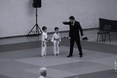 Jiu Jitsu fighters with Referee at Romanian Championship, Juniors, May 2018. Jiu Jitsu students in Kimono with Referee on tatami. Jiu-Jitsu Romanian Championship Stock Photography