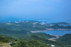 Jiufen. Panoramic aerial View of Jiufen with Keelung port and Sea from jiufen old street royalty free stock photos