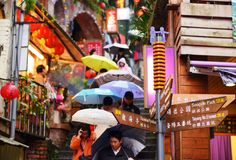 Jiufen. TAIWAN - JANUARY 17: Tourists walk down famed steps January 17, 2013 in Taipei, TW. A gold mining town developed under Japanese rule, the city now royalty free stock photo