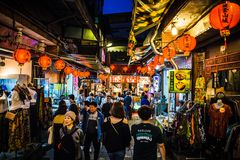 Jiufen. Taiwan - June 6, 2018: Busy street scene with many tourist walking in the narrow shopping street at stock photo