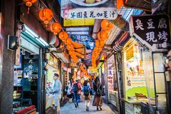 Jiufen. Taiwan - June 6, 2018: Busy street scene with many tourist walking in the narrow shopping street at stock photography