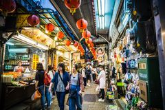 Jiufen. Taiwan - June 6, 2018: Busy street scene with many tourist walking in the narrow shopping street at stock photos