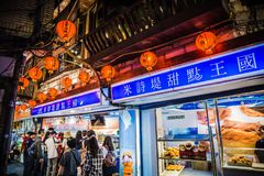 Jiufen. Taiwan - June 6, 2018: Busy street scene with many tourist walking in the narrow shopping street at royalty free stock images
