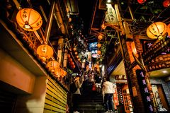 Jiufen. Taiwan - June 6, 2018: Busy street scene with many tourist walking in the narrow shopping street at royalty free stock photos