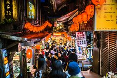 Jiufen. Taiwan - June 6, 2018: Busy street scene with many tourist walking in the narrow shopping street at stock images