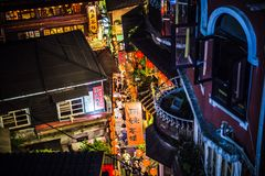 Jiufen. Taiwan - June 6, 2018: Busy street scene with many tourist walking in the narrow shopping street at royalty free stock image