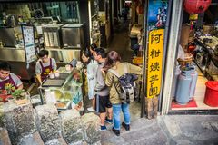 Jiufen. Taiwan - June 6, 2018: Many tourist queuing up for  old street`s famous Taro Rice Ball, it`s basically served with red bean, cream milk, grass jelly royalty free stock images