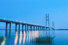 Jiujiang yangtze river highway bridge in nightfall Stock Photos