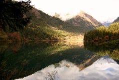 """Jiuzhaigou's """"Mirror Lake"""" reflecting the Min mountains on a calm morning in Sichuan, China. stock photos"""