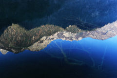 Jiuzhaigou's reflection in the water.  Stock Photography