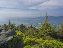 Jizera Mountains jizerske hory panorama, view from hill Frydla. Ntske cimburi, Friedlander Zinne with lush green spruce forest and blue sky, white clouds Stock Photography