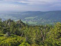 Jizera Mountains jizerske hory panorama, view from hill Frydla. Ntske cimburi, Friedlander Zinne with lush green spruce forest and blue sky, white clouds Royalty Free Stock Photography