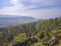 Jizera Mountains jizerske hory panorama, view with lush green. Spruce forest and blue sky, white clouds background, springtime Stock Photos