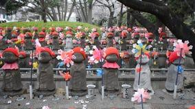 Jizo Bodhisattvas in Zojo Buddhist Temple, Tokyo, Japan stock footage