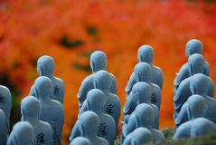 Jizo and foliage color Royalty Free Stock Image