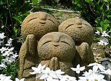 Jizo in garden Stock Photography