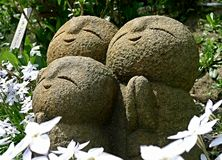 Jizo in garden Stock Photo