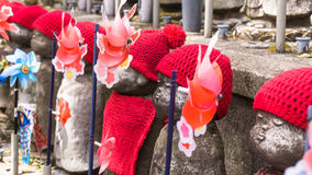 Jizo Japanese sculptures at Zojoji Temple in spring time at Toky Royalty Free Stock Photography
