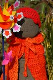 Jizo with pinwheel Royalty Free Stock Images