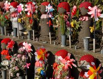 Jizo with pinwheel Royalty Free Stock Photo