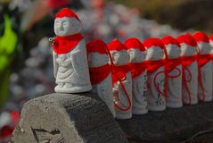 Jizo with red hats lining up Stock Photo