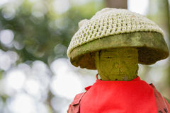 Jizo Statue with Red Apron Royalty Free Stock Photo