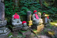 Jizo statues Buddhas statues in Kanmangafuchi abyss Nikko Japan. Tourist hot spot royalty free stock images