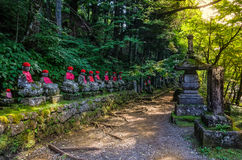 Jizo statues Buddhas statues in Kanmangafuchi abyss at sunset Nikko Japan. Jizo statues Buddhas statues in Kanmangafuchi abyss Nikko Japan tourist hot spot royalty free stock images