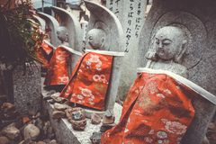 Jizo statues in Arashiyama temple, Kyoto, Japan. Jizo statues with red bibs in Arashiyama temple, Kyoto, Japan Royalty Free Stock Photo