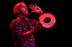 Jj grey playing tambourine Stock Photos