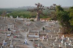 Muslim and Christian graveyard in Joal-Fadiouth, Petite Côte, Senegal. Joal-Fadiouth is a town in the Thiès Region at the southern end of the Petite Côte of Stock Image