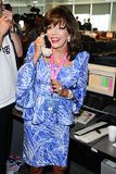 Joan Collins. On the trading floor of BGC as part of the BGC Charity Day 2012, Canary Wharf, London. 11/09/2012 Picture by: Steve Vas / Featureflash Stock Photo
