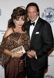 Joan Collins and Percy Gibson Stock Photo