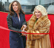 Joan and Melissa Rivers. Melissa and Joan cut the red ribbon to celebrate their induction into the Gray Line New York Ride of Fame campaign.  The event was held Royalty Free Stock Photography