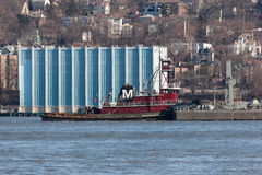 Joan Moran Tugboat on the Hudson River. ALPINE, NEW JERSEY, UNITED STATES - January 1, 2017: The Joan Moran tug boat is seen working on the Hudson River near Royalty Free Stock Photography