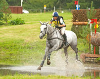 Joanna Rimmer riding for Great Britain. Joanna Rimmer riding through the water in the cross country at Blair Castle International Horse trial on 25th August 2012 Stock Photo