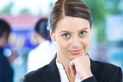 Job. Portrait of young pretty woman in business environment Stock Photography