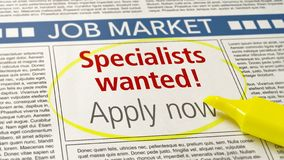 Job ad in a newspaper - Specialists wanted royalty free stock photography