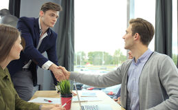 Job applicant having interview. Handshake while job interviewing. Stock Photos