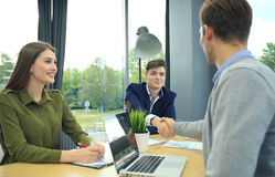 Job applicant having interview. Handshake while job interviewing. Royalty Free Stock Photo