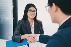 Job applicant having interview. Handshake while job interviewing Stock Photography