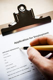 Job application. Person filling out a job application Royalty Free Stock Images