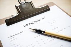 Job application. A clipboard with a job application and pen Stock Photos
